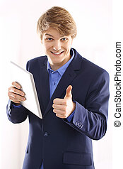 Happy office worker with a tablet