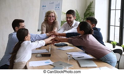 Happy old ceo unite team stack hands together, slow motion