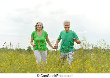 happy old couple at the nature