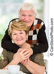 happy old couple - portrait of happy old couple at home