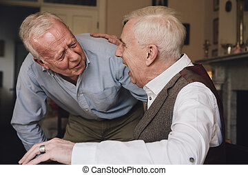 Happy Old Friends - Two senior men are laughing hysterically...