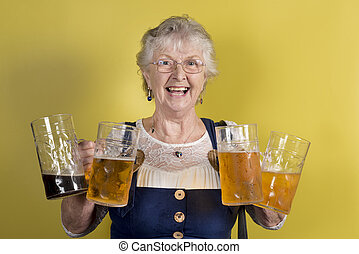 Happy Old Lady Holding Four Big Crystal Mugs with Beer