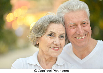 Beautiful happy old people in the summer park