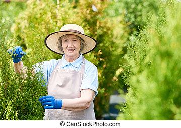 Happy Old Woman Posing in Garden