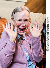 Happy Old Woman - Happy old woman with a hands up gesture