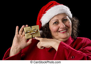 Happy Old Woman with Red Cap Points at Xmas Gift
