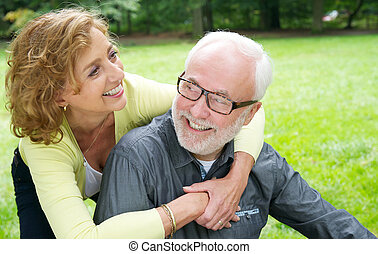 Happy older couple laughing outdoors