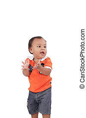 Happy one year old baby boy walking on white background