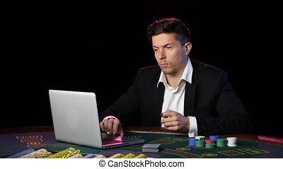 Happy online poker player winning in casino. Close up