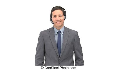 Happy operator with earpiece against a whit background