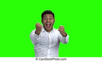 Happy overjoyed businessman on green screen. Excited man...