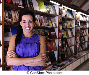 happy owner of a bookstore - small business: happy owner of...
