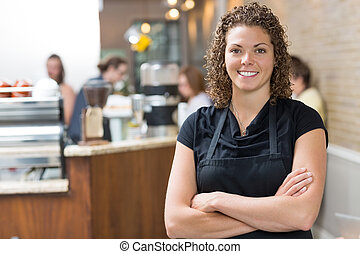 Happy Owner Standing Arms Crossed In cafe - Portrait of ...