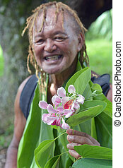 Happy Pacific Islander man gives an exotic flower on eco ...