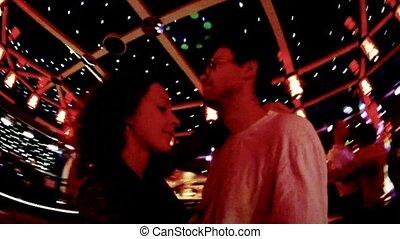Happy pair dances slow dance in night club