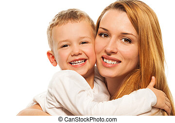 Happy parenting - smiling and laughing young mother with ...