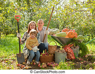 Happy parents and child in garden