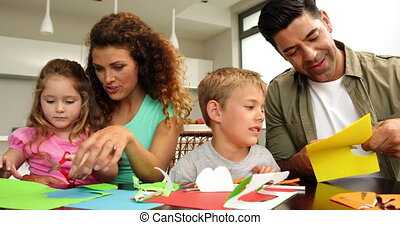 Happy parents and children doing crafts
