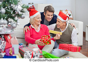 Happy Parents And Son With Christmas Presents