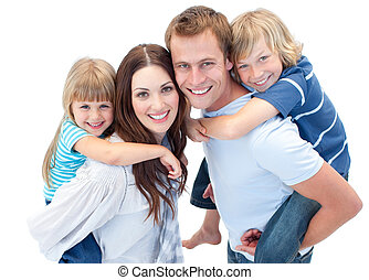 Happy parents giving their children a piggyback ride against white background