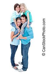 Happy parents giving their children piggyback ride