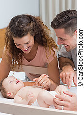 Happy parents playing with baby