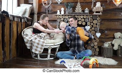 Happy parents playing with his son in the airplane