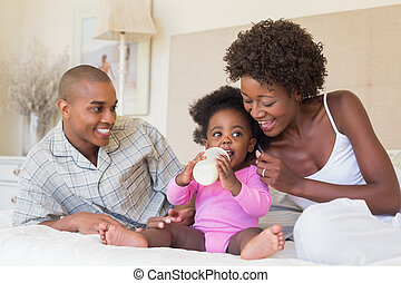 Happy parents with baby girl on the