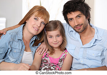 happy parents with daughter