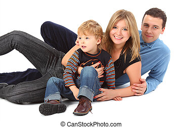 Happy parents with son laying