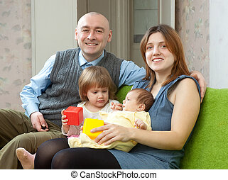 Happy parents with their two baby