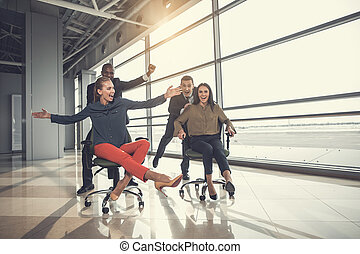 Happy partners riding on chairs