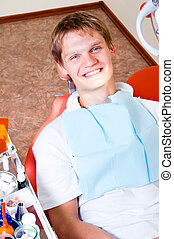 Happy patient in dental chair
