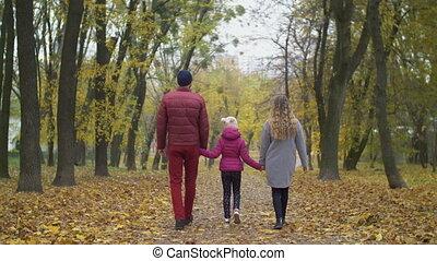 Happy patrents enjoying fresh air in autumn nature - Rear...