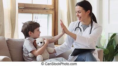 Happy pediatrician doctor encouraging preschool kid boy ...