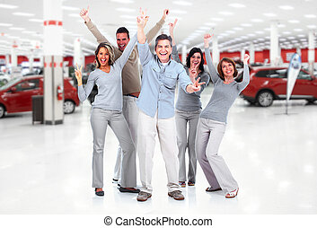Happy people group near new cars.