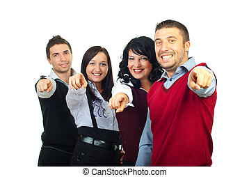 Happy people group pointing to you