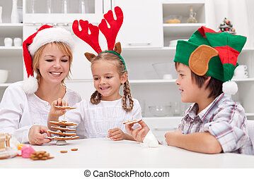 Happy people making gingerbread christmas tree