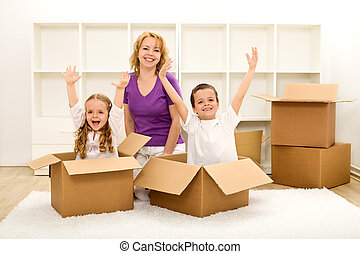Happy people moving in a new home - Happy family moving into...