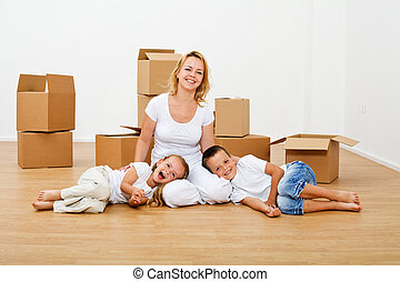 Happy people moving into a new house