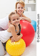 Happy people relaxing during gym exercises