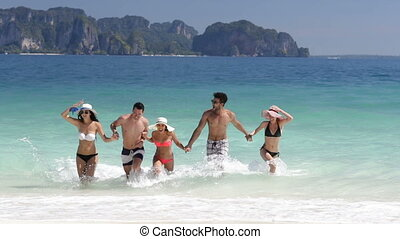 Happy People Running From Water Holding Hands On Beautiful...