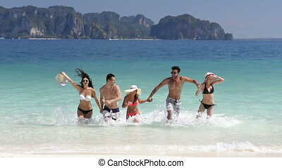 Happy People Running From Water On Beautiful Beach, Man And...