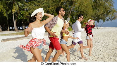 Happy People Running To Water Raising Hands On Beach, Mix...