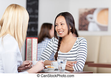happy people talking in cafe