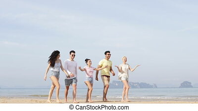 Happy People Walking On Beach Talking, Cheerful Young...