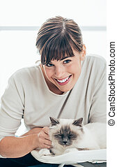 Happy pet owner with her cat