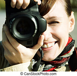 HAPPY PHOTOGRAPHER - Happy young woman with camera, toned, ...
