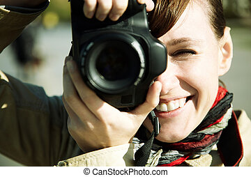happy photographer - happy young woman with camera, toned,...