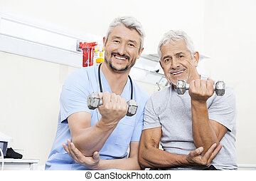 Happy Physiotherapist And Senior Patient Lifting Dumbbells